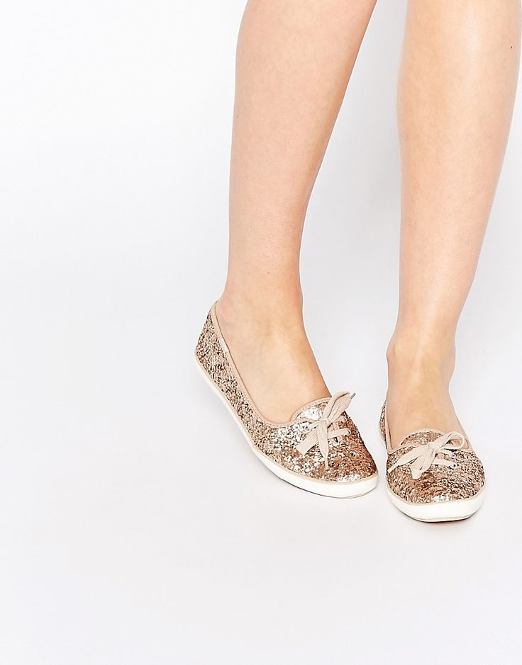 Image 1 ofKeds Teacup Gold Glitter Plimsoll Trainers