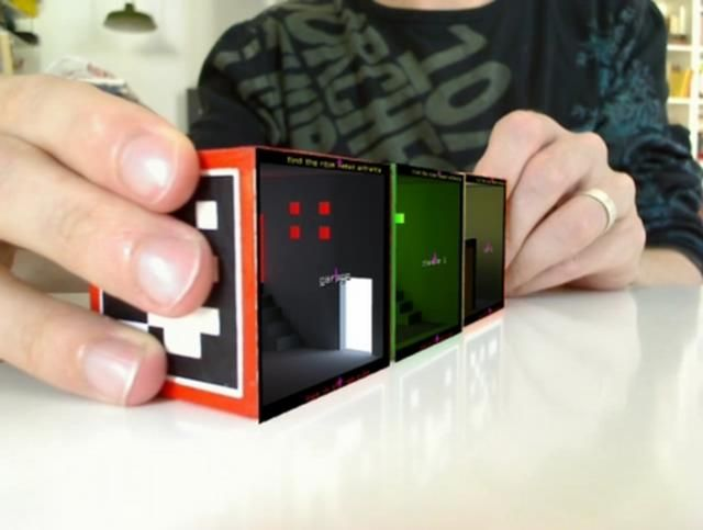 levelHead is an augmented-reality game. Tilt the cube and your little guy walks around and escapes from things. WANT THIS SO MUCH!