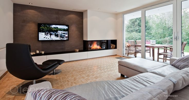 moderner eck kamin mit bose videowave system und einbauschr nken r ckwand mit kalk marmor. Black Bedroom Furniture Sets. Home Design Ideas
