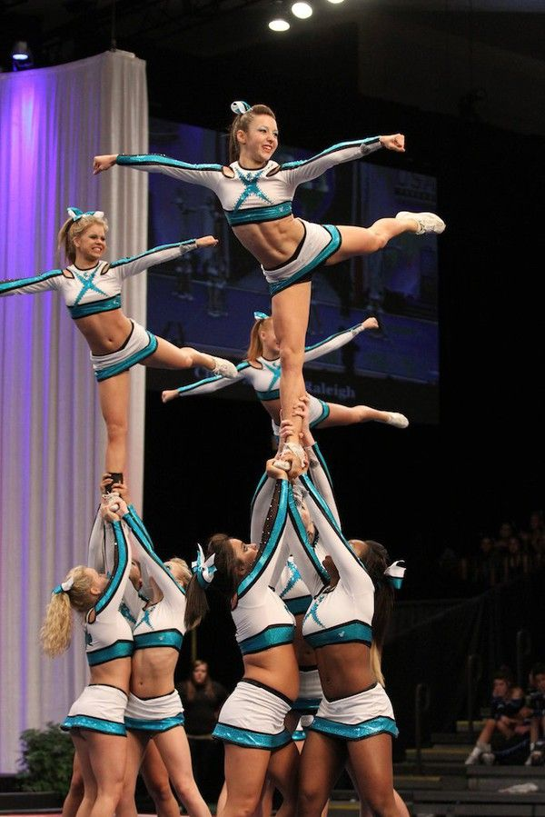 Cheer Extreme stunt cheerleaders competition arabesque from Kythoni's Cheerleading: Competitive board http://pinterest.com/kythoni/cheerleading-competitive/  m.at.0.8