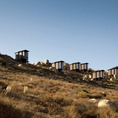 Encuentro Guadalupe: This hotel by Mexican architects Gracia Studio comprises 20 separate cabins dotted across the landscape in one of Mexico's wine-making regions. Located in the Valle de Guadalupe, the single-storey huts are lifted off the ground on steel frames so that they impact as little as possible the earth below. Corten steel panels overlap one another to clad the exterior walls and the pitched roofs are covered with corrugated panels of the weathered metal. Each room contains one…