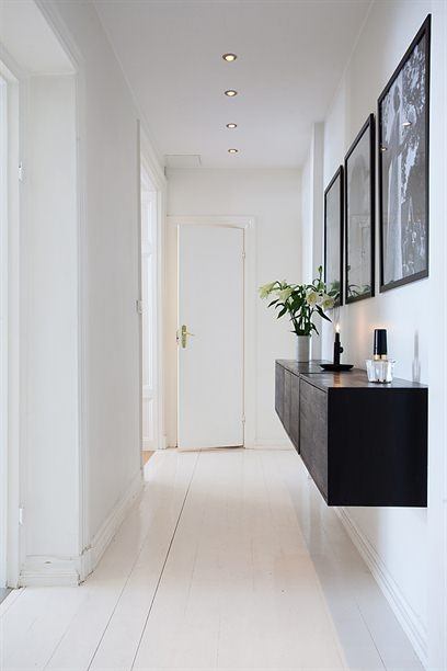 Hallway: Floating Shelves, Floors, Clean Line, Black Cabinets, Hall Tables, Black White, White Hallways, Hallways Ideas, Hallways Storage