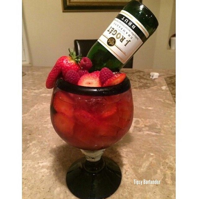 DRUNK IN LOVE 2 oz. (60ml) Strawberry Vodka 1 oz. (30ml) Triple Sec 1/2 oz. (15ml) Grenadine 2 oz. (60ml) Strawberry Mix Small Champagne Bottle Raspberries/Strawberries