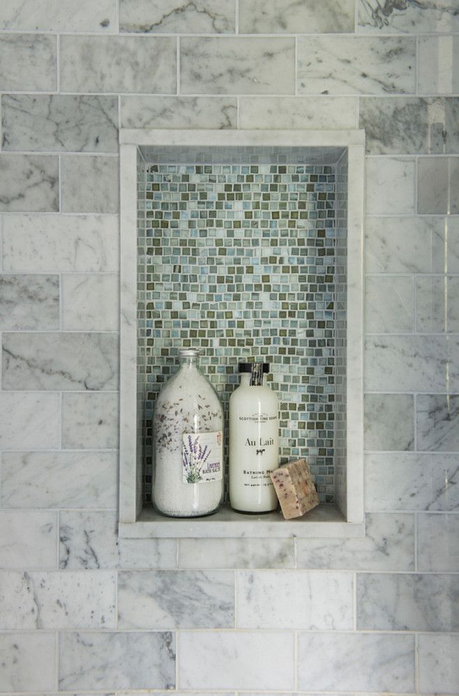tile creates contrast against the marble in this shower niche niche