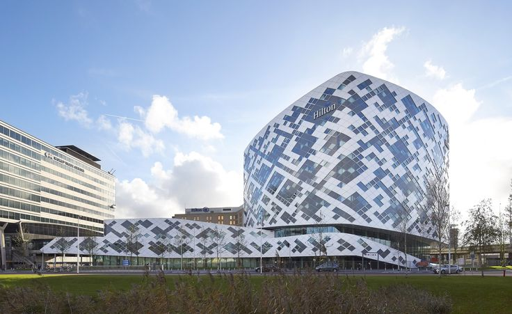 For travellers, airport hotels have long been about as inspiring as airline food. However, with the opening of the Hilton Amsterdam Airport Schiphol, both the airport and the hotel group have set out to up the ante. Iconic was the brief, and with its r...