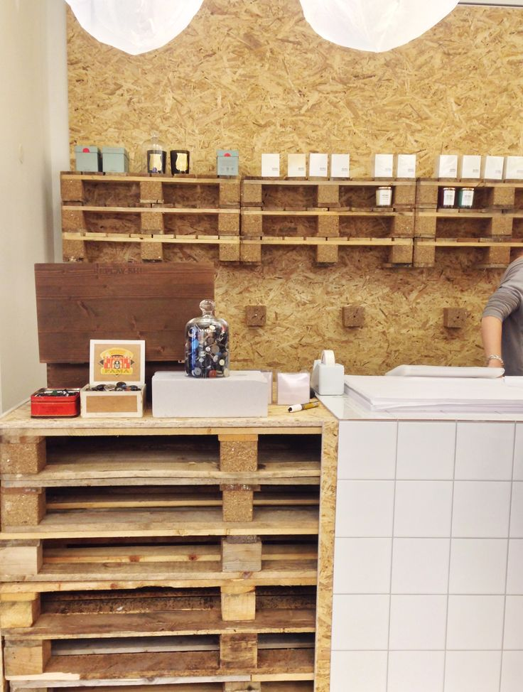 pop up store the netherlands: pallets, tiles and chipboard by judithvanmourik | interior architecture