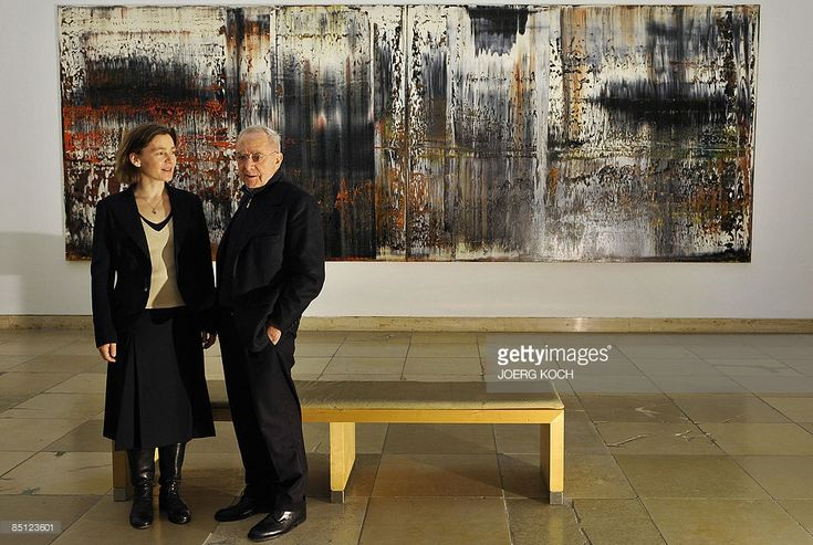 German painter Gerhard Richter and his wife Sabine Moritz pose in front of Richter's work 'St. Gallen (1989)' during a press preview of the exhibition 'gerhard richter - abstract pictures' at the Haus der Kunst museum in Munich, southern Germany, on February 26, 2009. From February 27 to May 17, 2009, the museum presents a comprehensive selection of Gerhard Richter�s abstract paintings that he created since the mid-1970s and that dominate his opus today.