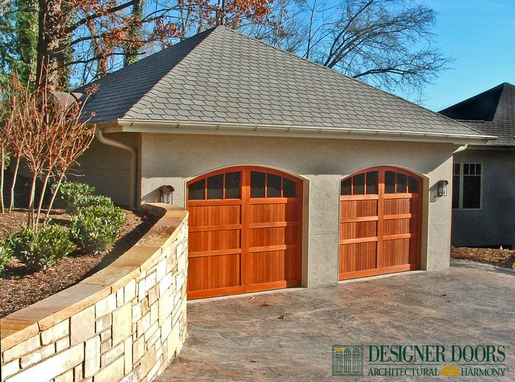 designer doors handcrafted pioneer wood garage doors are custom made in the usa proven to withstand use and weather