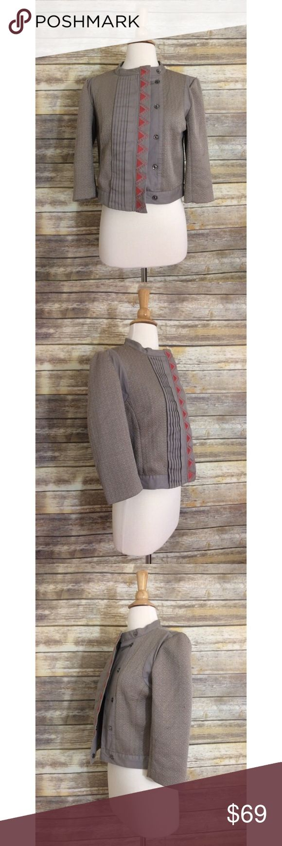 BCBGeneration Taupe Embroidered Triangle Jacket Cropped spring jacket from BCBGeneration with 3/4 sleeves in a taupe/light brown color. Fastens with buttons down the front and is detailed with pleats and coral colored embroidery. The tag size is Medium but it fits more like a Small. There may be a few loose strings here and there but is otherwise in very good condition. Please comment with questions or requests for measurements :) BCBGeneration Jackets & Coats