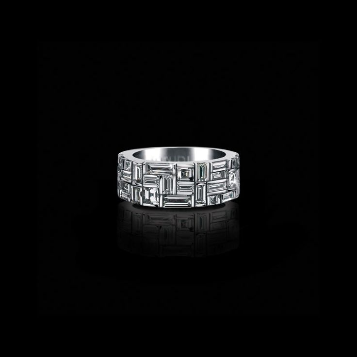 Canturi Cubism wide ring featuring baguette and carré cut diamonds in 18kt white gold, also available in yellow and pink gold