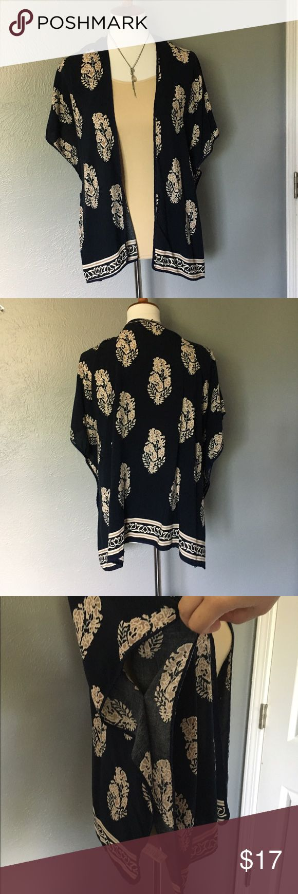 """💥Blue Kimono, tunic, cover up, short sleeved Dark blue/ cream short sleeve kimono.  This beautiful cover up goes with everything!  No visible wear- excellent condition!  Is open on the sides.  One size, because of the design it will fit a variety of sizes.  Length: 26"""", width: 29""""       👚 Check out more tops in my closet 👚                                 💥 To Post Office same/ next day 💥                                        🔥 Smoke-free home 🔥 Tops Tunics"""
