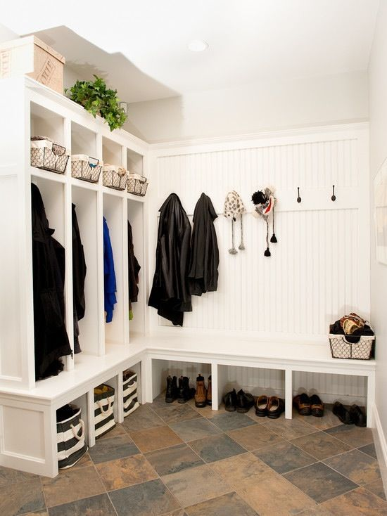 i liked the idea of the mudroom. it is spacious and enough space for storage. the shoe rack, the space for clothes and baskets above for storage too. good lighting and good texture of floor.