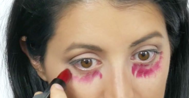 Use Red Lipstick To Conceal Dark Under-Eye Circles via LittleThings.com
