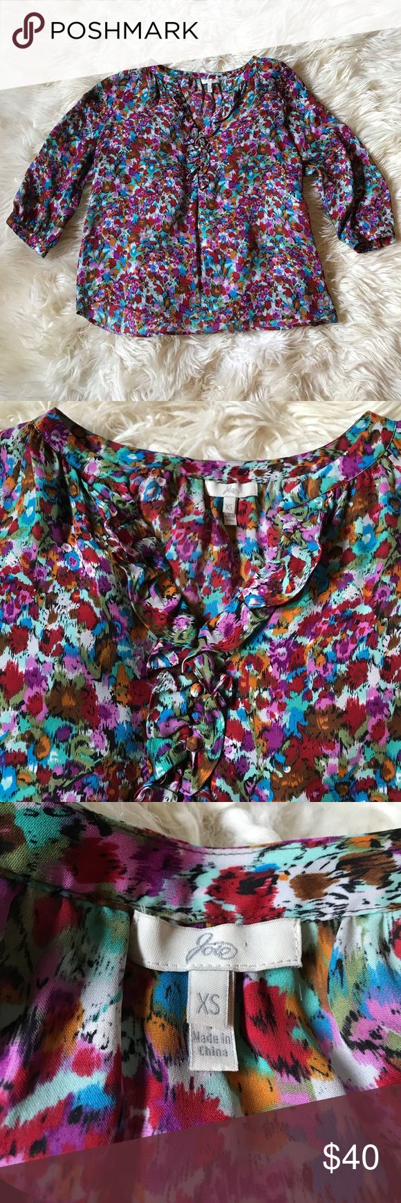 """Joie Floral Silk Blouse Bright Multicolored floral blouse by Joie. This flirty top features 100% silk floral material, a subtle ruffled neckline and fabric covered buttons on the sleeves. It pairs perfectly with a pencil skirt or jeans. Size xsmall. Length 23."""" Joie Tops"""