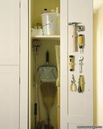 Screw hooks and spring-loaded clips inside and use them to hold brooms, a dustpan, mop, and duster. Do the same with tools on the door and you won't have to get out the toolbox for quick repairs.