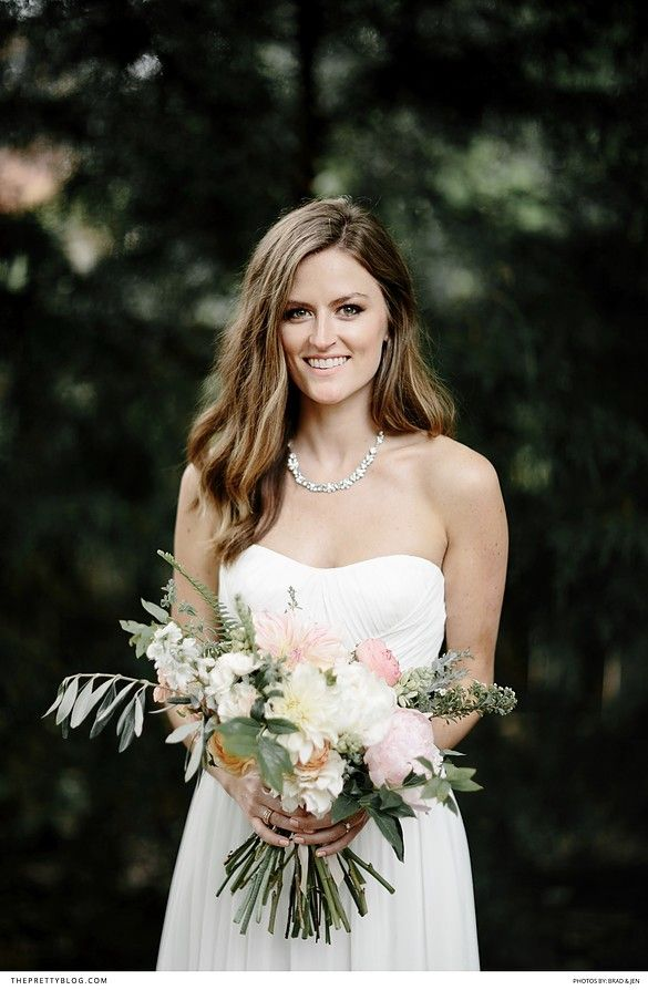 Beautiful strapless two piece wedding dress with pink and green bouquet and relaxed loose hair!  https://www.theprettyblog.com/wedding/this-trendy-nashville-plantation-wedding-is-one-for-the-ages/?utm_campaign=coschedule&utm_source=pinterest&utm_medium=The%20Pretty%20Blog&utm_content=This%20Trendy%2C%20Nashville%20Wedding%20Is%20One%20for%20the%20Ages