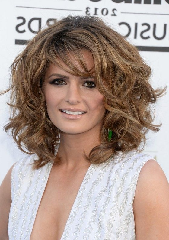 Stana Katic Layered Medium Curly Hairstyle with Bangs for Thick Hair