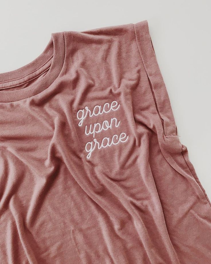 Check out your new favorite dusty rose EMBROIDERED t-shirt. This one features a flowy silhouette, rolled cuffs, and a raw, high-low hemline. And it's super soft! The high-low hemline looks great as is, or tucked into your go-to high waisted jeans, shorts, or denim skirt.