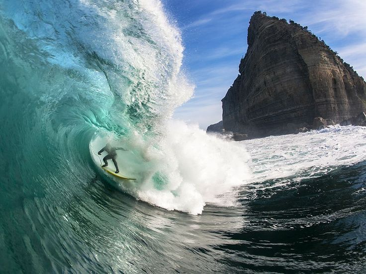 Picture of surfer Brook Phillips riding a large wave off the coast of Tasmania