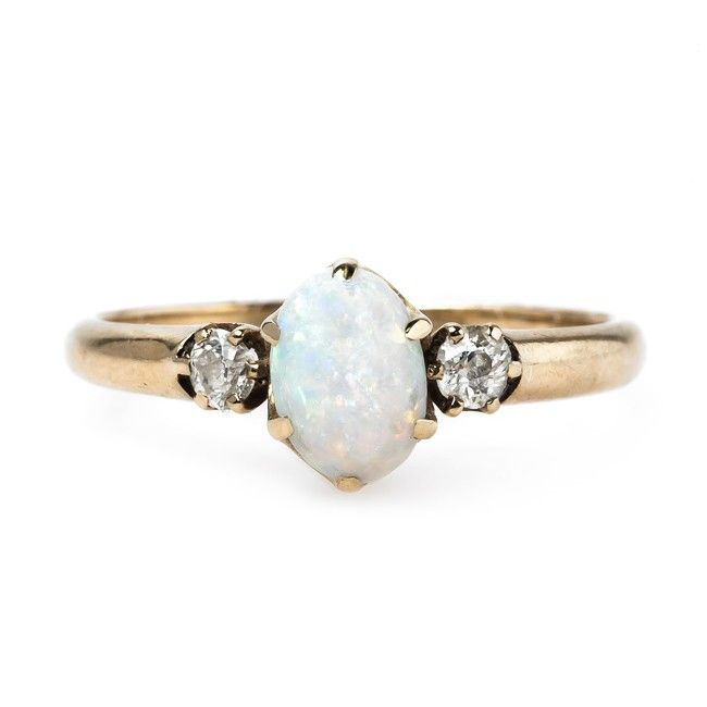 LOVE this opal engagement ring from Trumpet & Horn Ivory Weddings