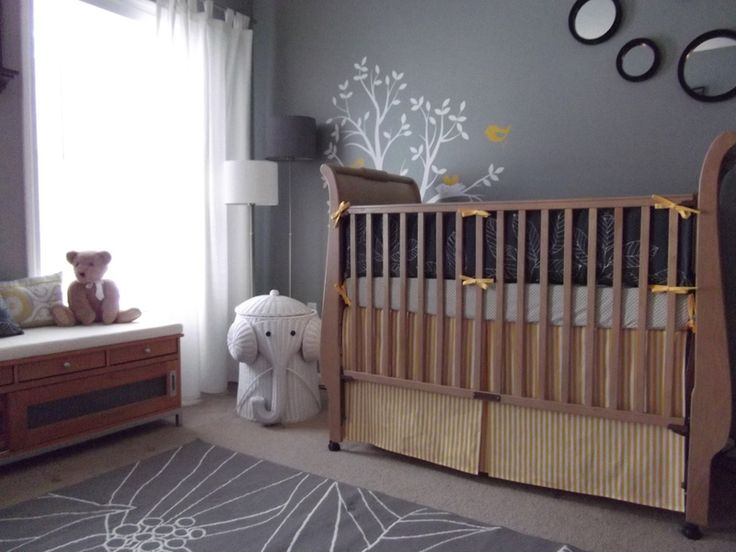 A natural finished crib in a neutral nursery. #gray #yellow #baby