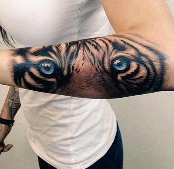 Tiger's eyes forearm tattoo