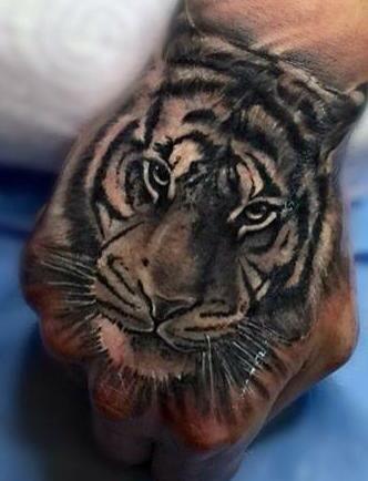 Tatuajes De Tigres En La Manopuños Tatuados Tatuajes De