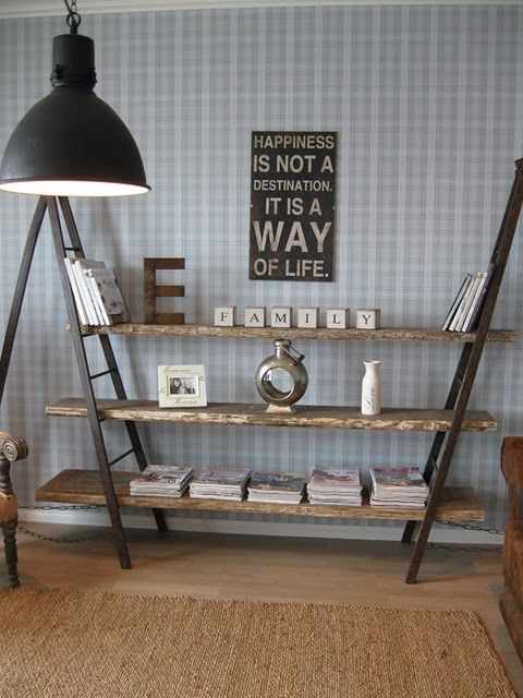 Industrial Vintage Ladder Shelves: ladders + wooden shelves = very easy to make (if you can find cheap vintage ladders whose rungs *match in height*--- this is a Must- otherwise, shelves wont be level)