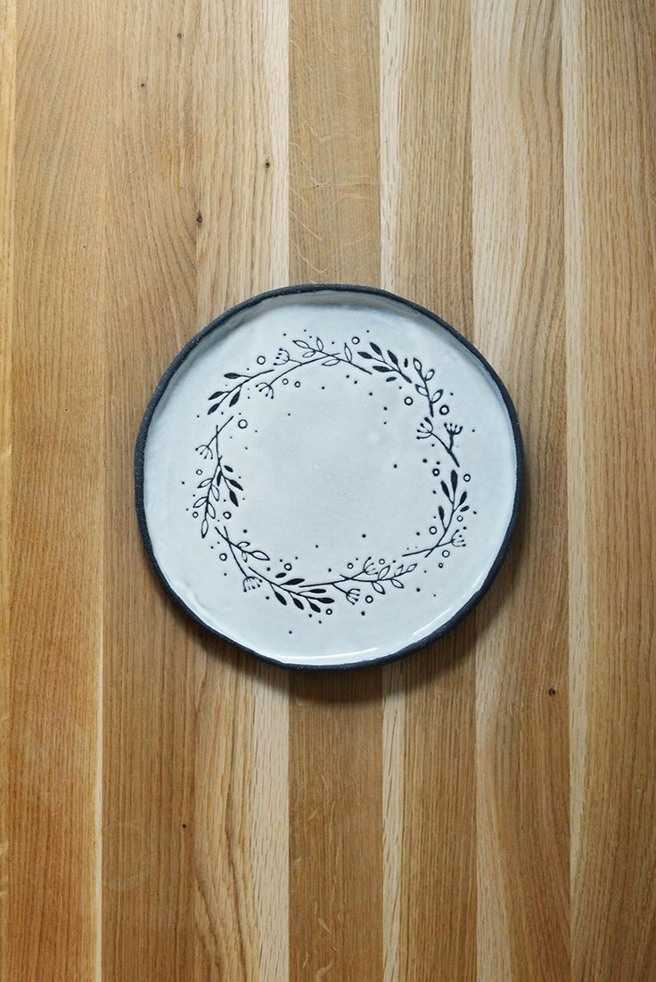 black clay plate and white glaze