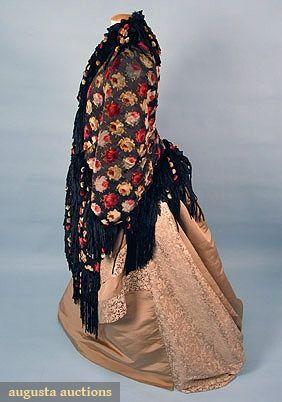 PRINTED DOLMAN JACKET, c. 1880 Black silk satin w/ multicolored velvet-flocked rose blossoms, trimmed w/ black chenille & colored ball fringes, lined in red fur plush
