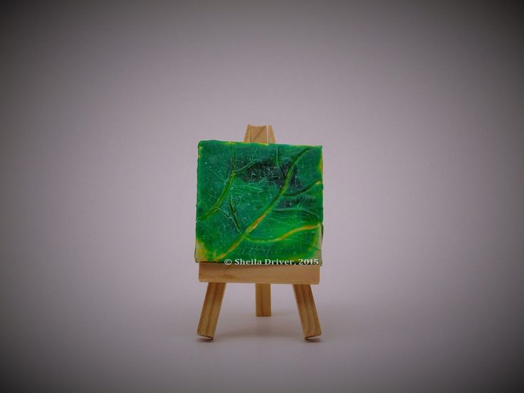 "Title: Little Leaf Size: 2.75'' x 2.75"" (7 cm x 7 cm)  This is an original encaustic painting, created entirely from a wax medium applied to a mini canvas frame, and comes with its own mini easel. This work is part of a series of paintings called Du Jardin, (meaning ""From the Garden"" in English)."