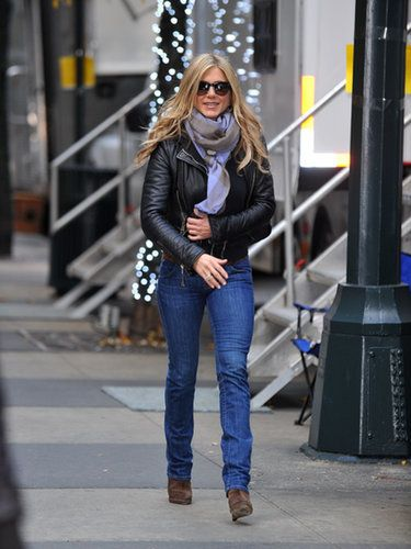 Jennifer Anniston pairs a leather jacket with a skinny, straight jean.