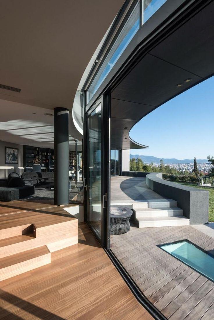 Wohnung mit schwarz-grauem Wohnzimmer – Die Terras…
