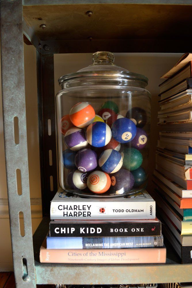 A glass container of pool balls is a cheap and easy way to add design to a room. This is especially fitting for a game room.