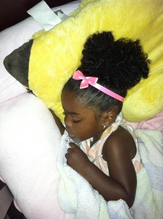 Love her dark skin n she is dame beautiful.