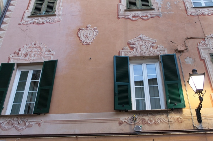 Building in the medieval center of Loano decorated with fine trompe l'oeil frescoes.