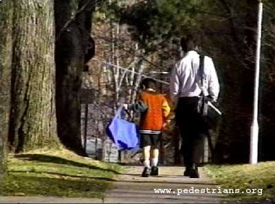 A parent walking their child to school in Bethesda, Maryland.  The benefits:  quality time together, fresh air and exercise, arriving to school awake and ready to learn, running into friends and neighbors, and developing spacial awareness skills at an early age.  The cost: $0.00  http://www.pedestrians.org
