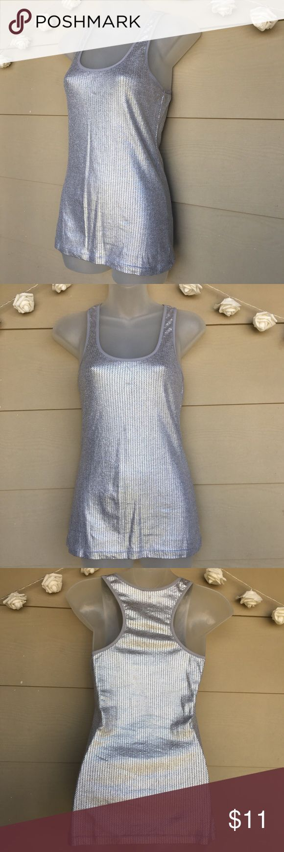 Energie • Metallic Silver Gray Tank Top Energie • Metallic Silver Gray Tank Top  —Size = Medium  —In Excellent Pre-Owned Condition —Bright silver color with a metallic finish. Perfect tank to give your outfit a pop! —Approx. Measurements laying flat:  •Armpit to armpit=14in •Length=25in    ?? Questions ?? — Please ask! :)  •Offers & counteroffers always welcome.  •All packages shipped fast with love & care. •Happy Poshing!! Energie Tops