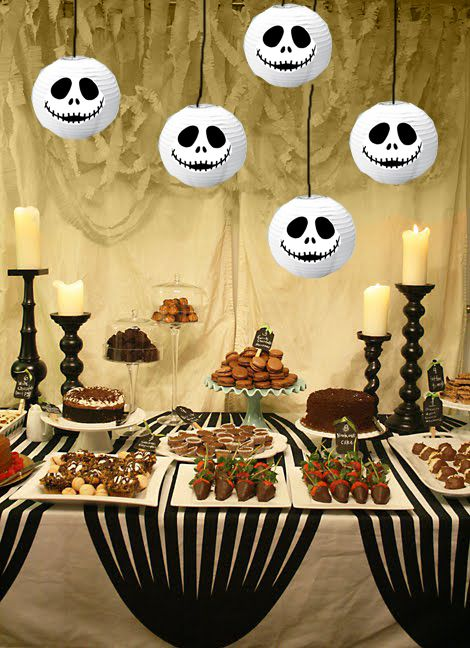 a few paper lanterns with jack skellington faces hung above stripes of black crepe paper - Halloween Design Ideas