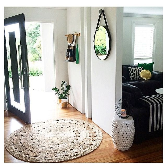 Straw rug and hanging mirror