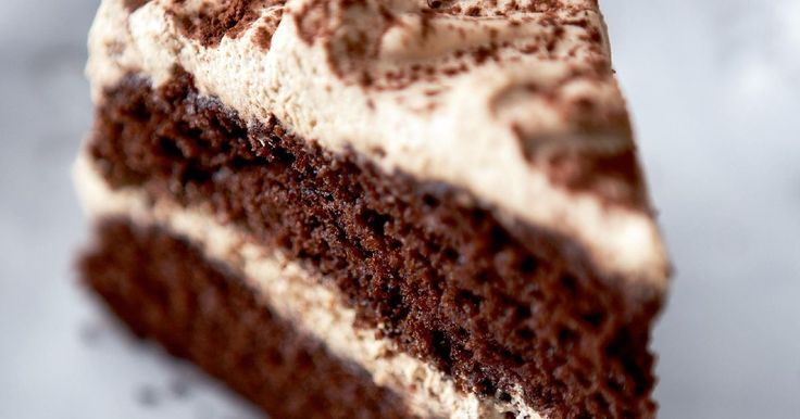 Turn your favourite hot drink into a beautiful bake with this elegant cappuccino cake. The Mary Berry cake is finished with a signature dusting of cocoa powder.
