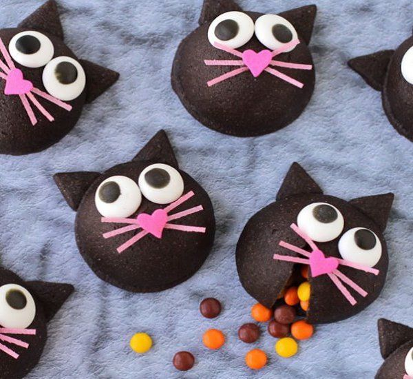 these wickedly cute candy filled black cat cookies will make the purr fect halloween treat each dimensional chocolate cookie is decorated and filled with