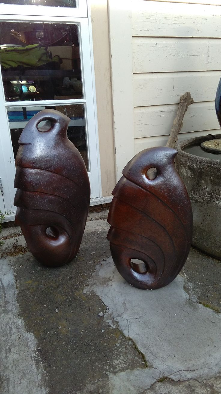 ceramic woodfired sculptures. bird forms, handbuild by coiling.