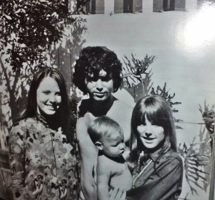 This photo is of Jim Morrison, Pamela, Jim's sister Anne, and nephew. Jim & Pamela loved children. When Jim was away touring, Pamela would often babysit. She even babysat Slash of Gun's and Rose's. She was good friends with his mother. Description from mygloombeauty.tumblr
