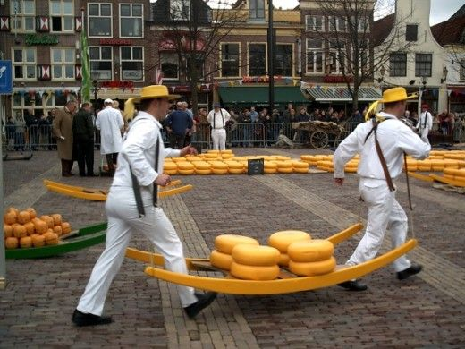 Cheese Hauling / These Dutchmen are doing what comes naturally to all Nederlanders, they're making off with the yellow cheese. Gouda. Old gouda and young gouda. Come back with that cheese!!
