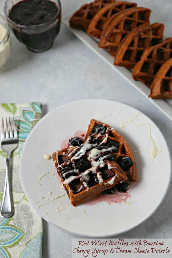 Red Velvet Waffles with Bourbon Cherry Syrup and drizzled with a sweet cream cheese glaze are rich, decadent and will have you swooning with each bite | Cooking In Stilettos