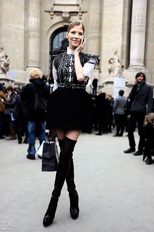ELENA PERMINOVA : dressed to party with    Above the knee black boots, short skirt, vest & top.