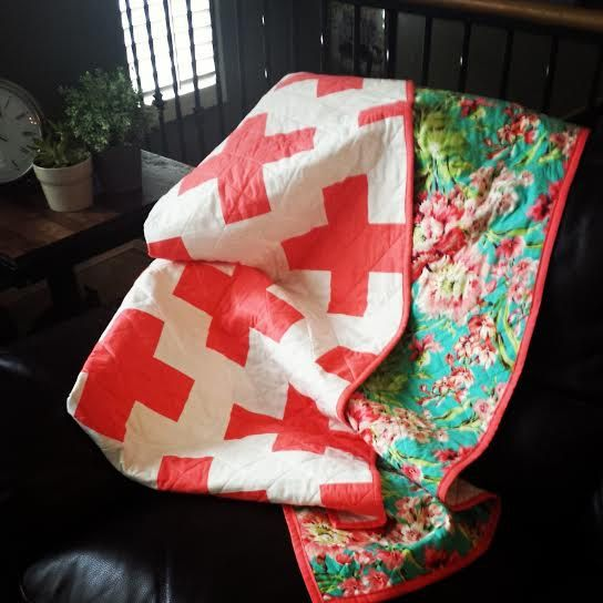BEAUTIFUL. Coral Plus quilt with contrasting floral backing. Just gorgeous.