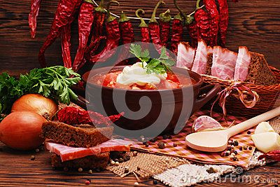The traditional national Ukrainian beet soup borscht on the old wooden background