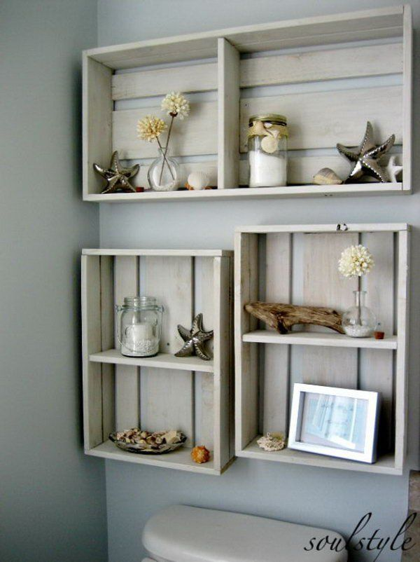 Hang some DIY crates on the area over the toilet to add some decor. The dried beach dahlias in tiny bubble vases, mason jars filled with candles
